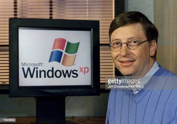 Microsoft chairman and chief software architect Bill Gates Gates poses for photographers next to a computer with the new Windows XP operating system...