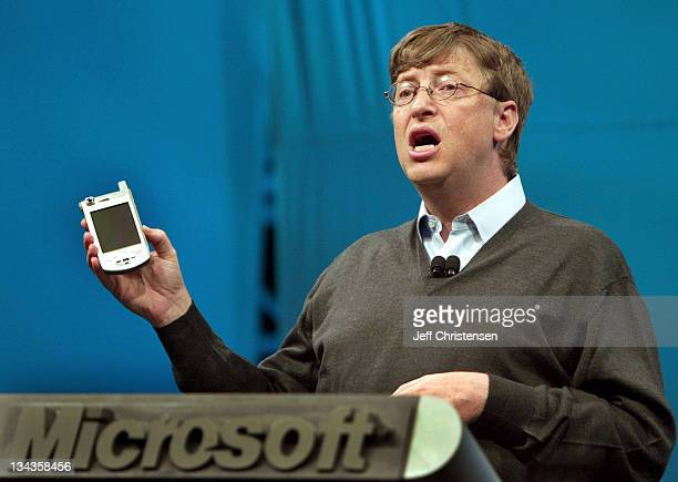 Microsoft Chairman and Chief Software Architect Bill Gates shows the new Windows Powered Pocket PC platform phone by Samsung at the Microsoft...
