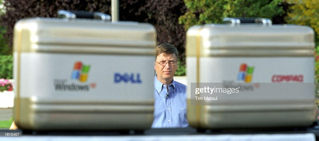 Microsoft Chairman and chief software architect Bill Gates waits to go onstage at the release of the Windows XP operating system August 24 2001 in...