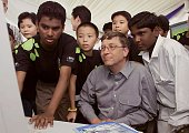 Microsoft Chairman Bill Gates shares a moment in front of a computer with Malaysian orphans at the Microsoft Knowledge Capital Centre in Cyberjaya 13...