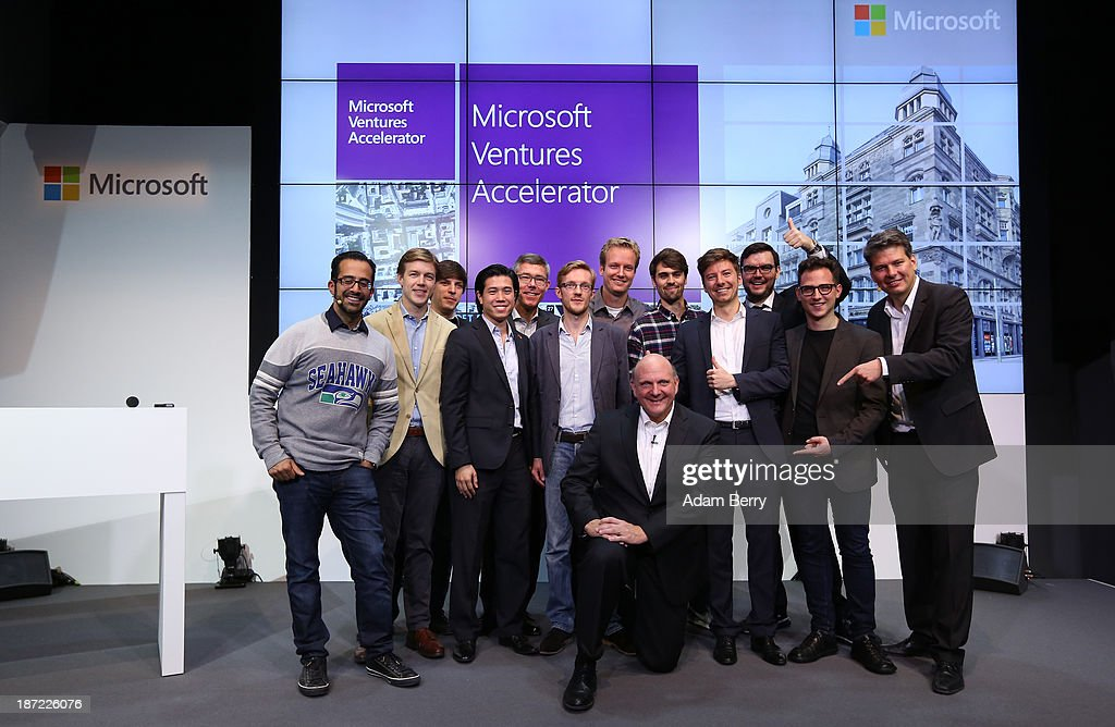 Microsoft Chief Executive <a gi-track='captionPersonalityLinkClicked' href=/galleries/search?phrase=Steve+Ballmer&family=editorial&specificpeople=211258 ng-click='$event.stopPropagation()'>Steve Ballmer</a> (C) poses with Rahul Sood (L) and Stephan Jacquemot (R), co-heads of the Microsoft Ventures Accelorator program, as well as the heads of the startups benefiting from it, at the opening of the Microsoft Center Berlin on November 7, 2013 in Berlin, Germany. The Microsoft Center Berlin, part of a new worldwide initiative called Microsoft Ventures, includes support for startups, conference rooms and the company's 'Digital Eatery,' a cafe and showroom on the ground floor that lets customers try out Microsoft products along with locally-sourced dishes. The company is hoping that the venue will help ensure Microsoft has a place in the city's Internet technology scene.