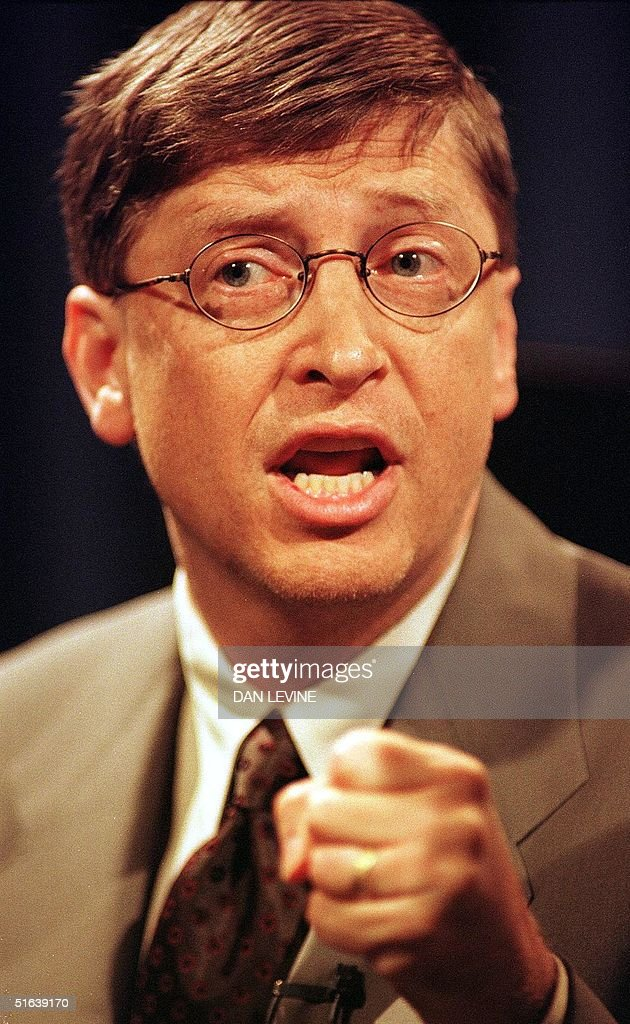 Microsoft co-founder and chairman Bill Gates clenches his fist during a press conference 18 May in Redmond, Washington state, while defining his company's position against the US Justice Department's lawsuit. Gates warned that the government would lose its antitrust case against the company and denounced charges it had sought to divide up the Internet browser market as an 'outrageous lie.' AFP PHOTO Dan Levine