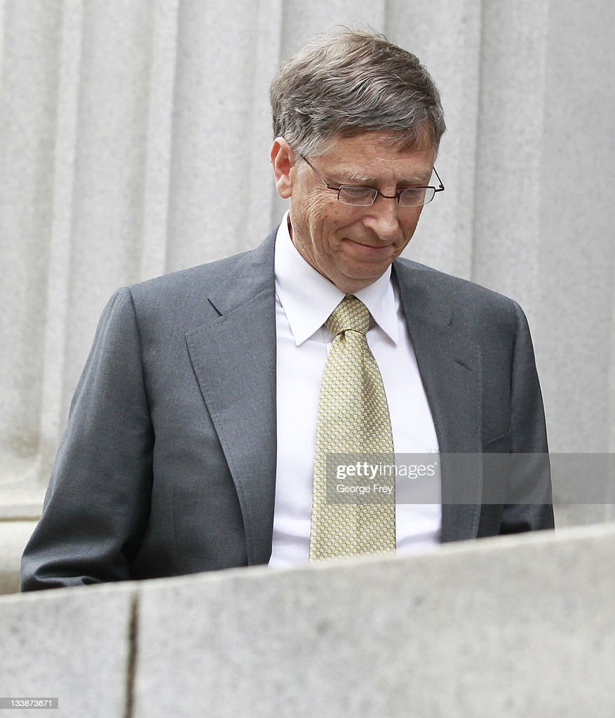 Microsoft cofounder Bill Gates leaves federal court after his first day of testimony to defend Microsoft against antitrust allegations leveled by...
