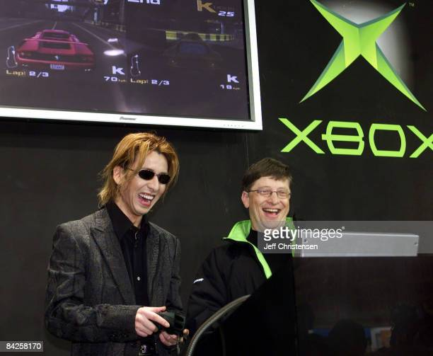 Microsoft Corp Chairman Bill Gates plays a game on the Xbox video game system with Japanese rock star Yoshiki during an event held to launch Xbox in...