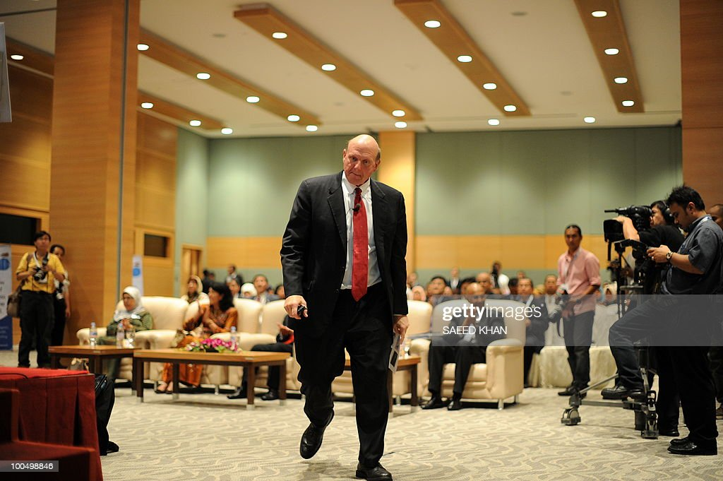 Microsoft Corp Chief Executive Officer Steve Ballmer walks towards the stage to give a presentation in Malaysia's administrative capital Putrajaya on May 25, 2010. Ballmer announced the availability of microsoft online services in Malaysia called Cloud Computing. The technology brings togather the internet, PCs, mobile devices and data centers to pool knowledge and network resources to work together better. AFP PHOTO/Saeed KHAN