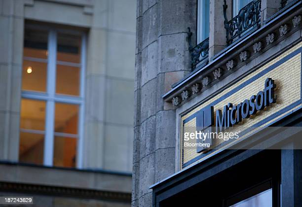 A Microsoft Corp logo sits on display outside the company's new store in Berlin Germany on Thursday Nov 7 2013 Microsoft Corp's board placed Chief...