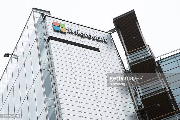 A Microsoft Corp logo sits on display outside the headquarters of Nokia Oyj in Espoo Finland on Tuesday May 5 2015 Nokia Oyj Chief Executive Officer...