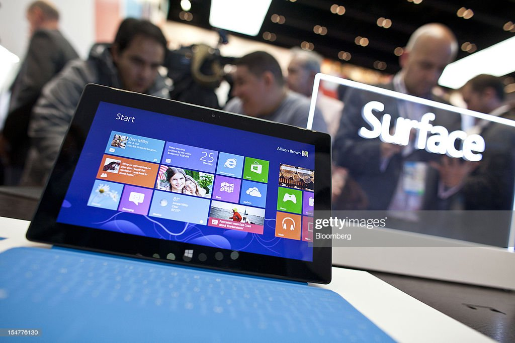 A Microsoft Corp. Surface tablet sits inside the company's store during its grand opening in New York, U.S., on Thursday, Oct. 25, 2012. Microsoft Corp. introduced the biggest overhaul of its flagship Windows software in two decades, reflecting the rising stakes in its competition with Apple Inc. and Google Inc. for the loyalty of customers who are shunning personal computers and flocking to mobile devices. Photographer: Ramin Talaie/Bloomberg via Getty Images