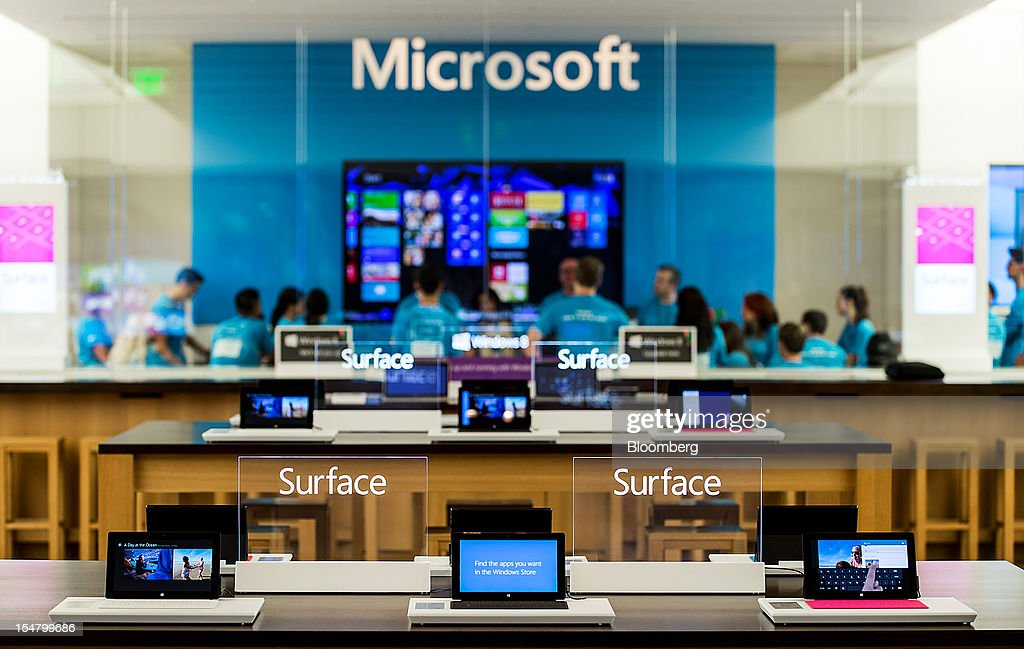 Microsoft Corp. Surface tablets computers are displayed at the opening of a store in Bellevue, Washington, U.S., on Friday, Oct. 26, 2012. Microsoft Corp. introduced the biggest overhaul of its flagship Windows software in two decades, reflecting the rising stakes in its competition with Apple Inc. and Google Inc. for the loyalty of customers who are shunning personal computers and flocking to mobile devices. Photographer: Stuart Isett/Bloomberg via Getty Images