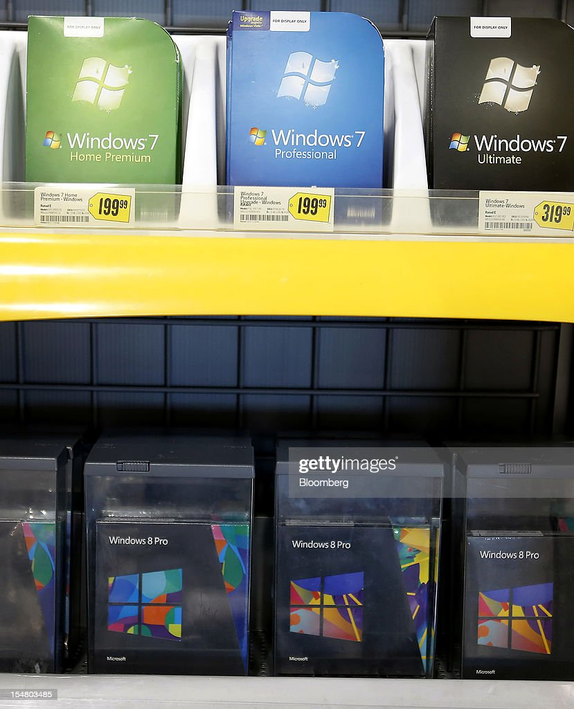 Microsoft Corp. Windows 7 and 8 operating systems are displayed for sale at a Best Buy Co. store in Orem, Utah, U.S., on Friday, Oct. 26, 2012. Microsoft Corp. introduced the biggest overhaul of its flagship Windows software in two decades, reflecting the rising stakes in its competition with Apple Inc. and Google Inc. for the loyalty of customers who are shunning personal computers and flocking to mobile devices. Photographer: George Frey/Bloomberg via Getty Images