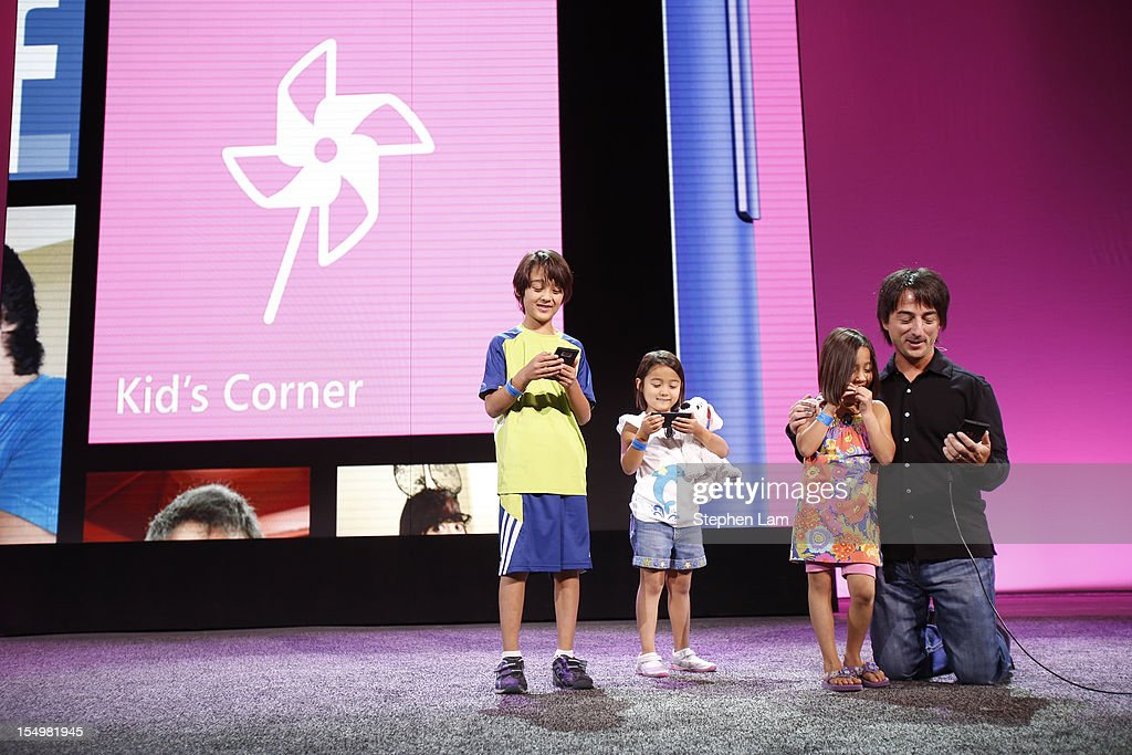 Microsoft Corporate Vice President Joe Belfiore (R) along with his children (L-R) Alexander, Sydney, and Piper introduce Windows Phone 8's Kid's Corner feature during a product launch at Bill Graham Civic Auditorium on October 29, 2012 in San Francisco, California. The Windows Phone 8 marks the Seattle-based company's latest update from its two-year-old Windows Phone 7 platform as the company looks to compete in the increasingly dense smartphone segment dominated by rivals Apple and Google.
