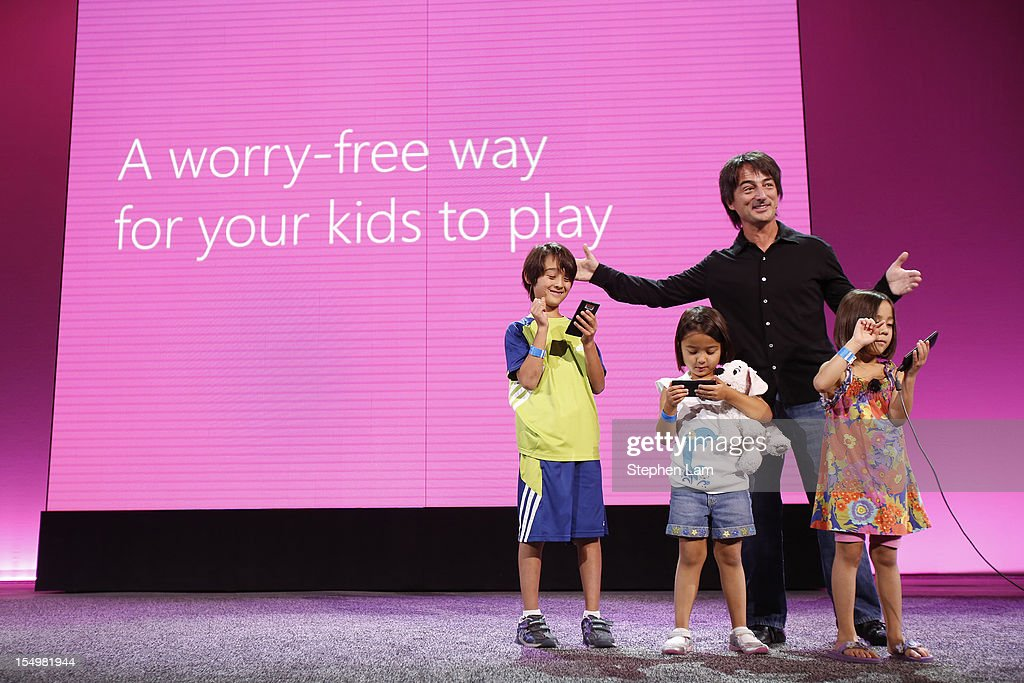 Microsoft Corporate Vice President Joe Belfiore, right, along with his children (L-R) Alexander, Sydney, and Piper introduce Windows Phone 8's Kid's Corner feature during a product launch at Bill Graham Civic Auditorium on October 29, 2012 in San Francisco, California. The Windows Phone 8 marks the Seattle-based company's latest update from its two-year-old Windows Phone 7 platform as the company looks to compete in the increasingly dense smartphone segment dominated by rivals Apple and Google.