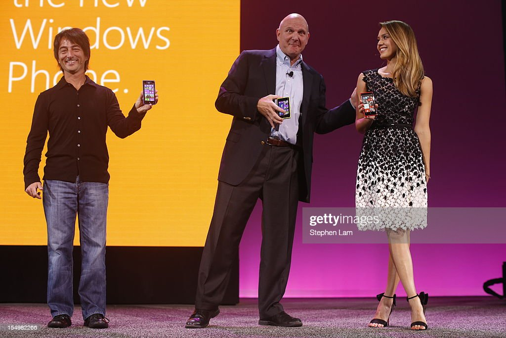Microsoft Corporate Vice President Joe Delfiore, CEO <a gi-track='captionPersonalityLinkClicked' href=/galleries/search?phrase=Steve+Ballmer&family=editorial&specificpeople=211258 ng-click='$event.stopPropagation()'>Steve Ballmer</a> and actress <a gi-track='captionPersonalityLinkClicked' href=/galleries/search?phrase=Jessica+Alba&family=editorial&specificpeople=201811 ng-click='$event.stopPropagation()'>Jessica Alba</a> hold a smartphone featuring Windows Phone 8 during a product launch at Bill Graham Civic Auditorium on October 29, 2012 in San Francisco, California. The Windows Phone 8 marks the Seattle-based company's latest update from its two-year-old Windows Phone 7 platform as the company looks to regain its traction in the increasingly dense smartphone segment dominated by rivals Apple and Google.