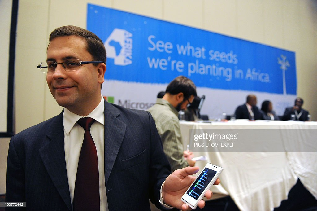 Microsoft Director, Mobility Windows Phone for Middle East and Africa, Gustavo Fuchs holds the Huawei 4Afrika, a full functionality Windows Phone 8 pre-loaded with select applications designed for Africa in Lagos on February 5, 2013. Microsoft Corporation has introduced the Microsoft 4Afrika initiative, a new effort through which the company will actively engage in Africa's economic development to improve its global competiveness.
