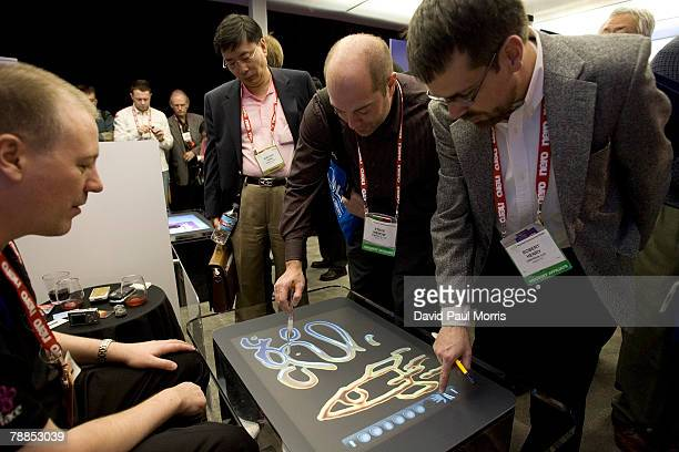 Microsoft employee shows people the new Microsoft Surface at the 2008 International Consumer Electronics Show at the Las Vegas Convention Center...