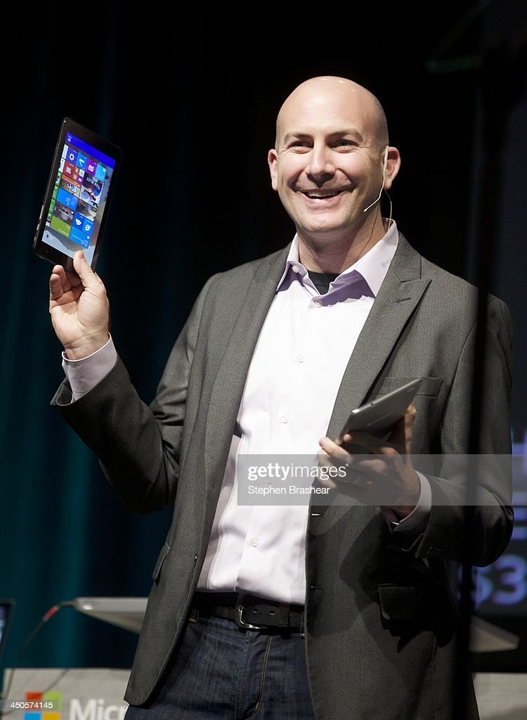 Microsoft Executive Communications Manager Ryan Asdourian demonstrates a part of tablets running Windows software during the Microsoft Shareholders Annual Meeting November 19, 2013 in Bellevue, Washington. Asdourian demonstrated several devices running windows operating systems and software.