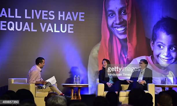 Microsoft founder Bill Gates and his wife Melinda in conversation with author Chetan Bhagat during a programme All Lives Have Equal Values at The...