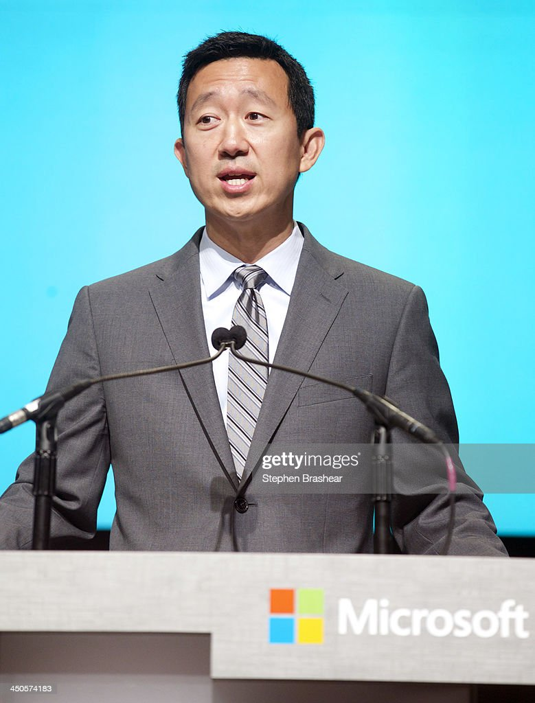 Microsoft General Manager of Investor relations Chris Suh speaks during the Microsoft Shareholders Annual Meeting November 19, 2013 in Bellevue, Washington. During the meeting all proposals were passed and board members reelected, including Chairman Bill Gates and CEO Steve Ballmer.