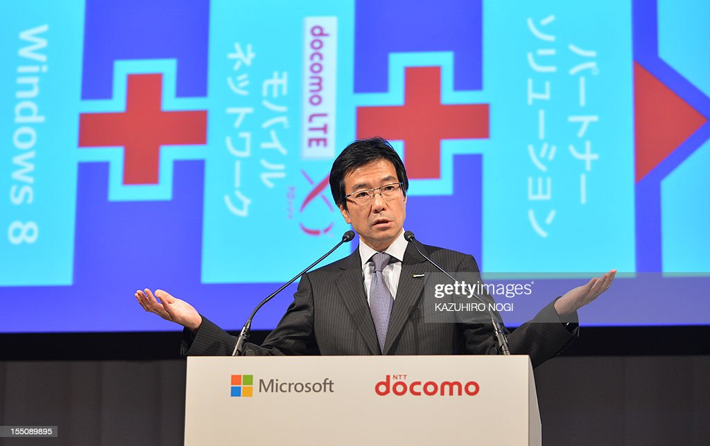 Microsoft Japan president Yasuyuki Higuchi delivers a speech during a joint press conference with NTT DOCOMO president Kaoru Kato (not pictured) in Tokyo on November 1, 2012. Microsoft Japan and NTT DOCOMO announced they have agreed on a cooperative business relationship to combine Windows 8 tablet devices and DOCOMO's extra-high-speed LTE mobile service, Xi (read 'crossy'), for corporate users in Japan.