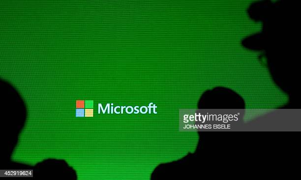 A Microsoft logo is pictured during the presentation of the Xbox One in Shanghai on July 30 2014 A Chinese probe into Microsoft is probably targeting...