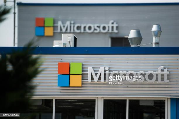 Microsoft logos sit on display on plant buildings at the Nokia Oyj mobile handset factory operated by Microsoft Corp in Komarom Hungary on Monday...