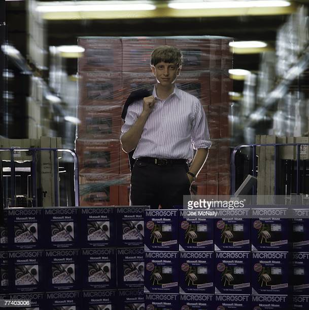 Microsoft owner and founder Bill Gates poses in front of hundreds of boxed Microsoft products in 1986 at the packaging facility in the new 40acre...