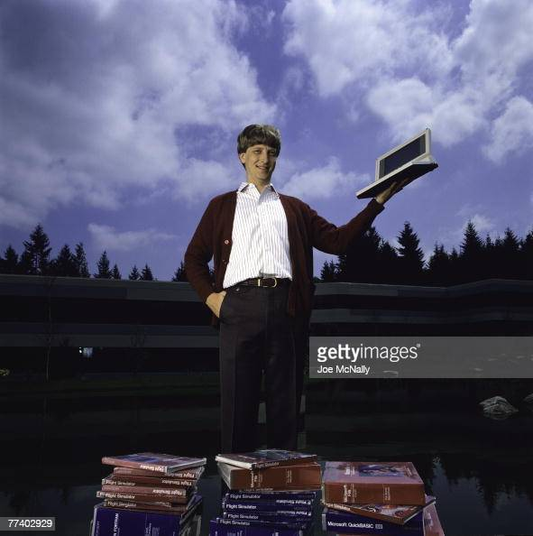 Microsoft owner and founder Bill Gates poses outdoors with Microsoft's first laptop in 1986 at the new 40acre corpororate campus in Redmond...