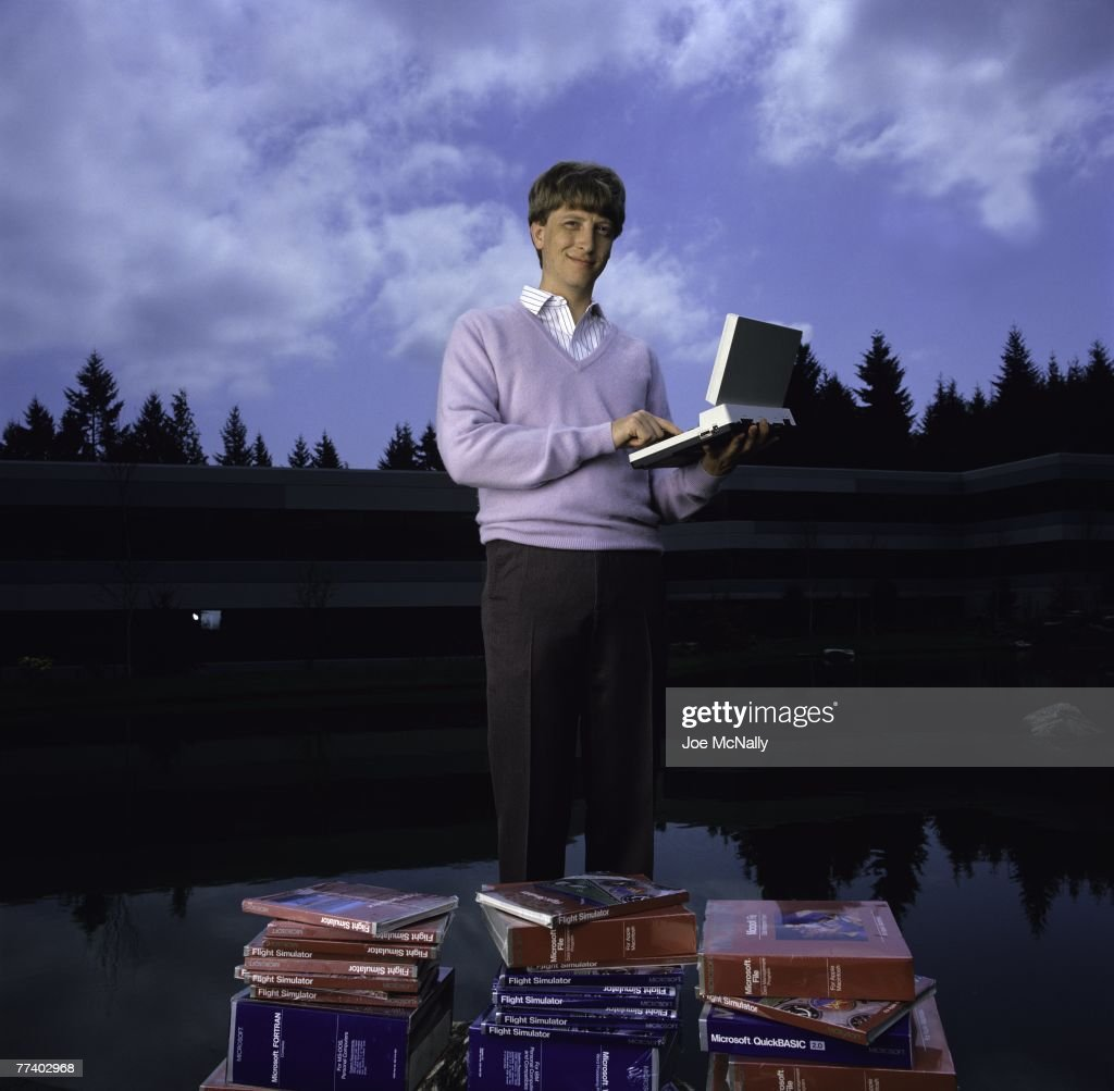 Microsoft owner and founder Bill Gates poses outdoors with Microsoft's first laptop in 1986 at the new 40-acre corpororate campus in Redmond, Washington. In March, Microsoft held an initial public offering of 2.5 million shares. By the end of the year, Gates became a billionaire at the age of 31. Microsoft was the first company to dominate the personal computer market with it's MS-DOS system and subsequently the Windows platform.