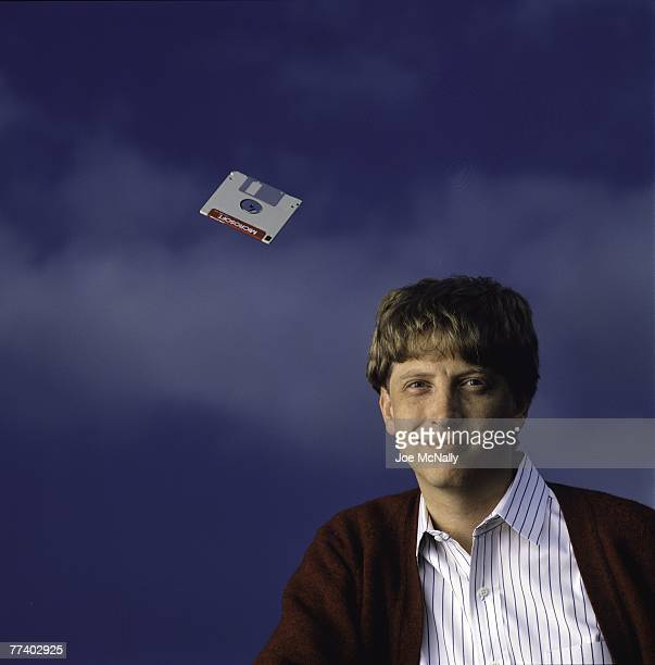 Microsoft owner and founder Bill Gates poses with a hovering floppy disk in 1986 at the new 40acre corpororate campus in Redmond Washington In March...