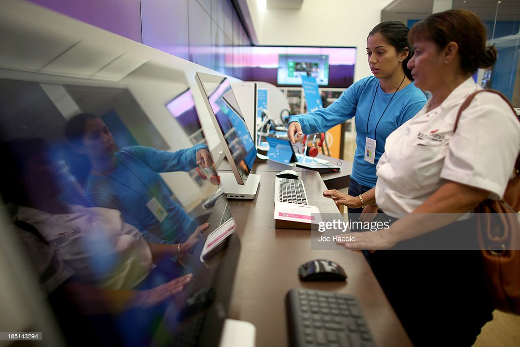 Microsoft Product Advisor Daniela Belevanon (L) helps Marta Aranda as she shops for a computer loaded with the Windows 8.1 operating system at a Microsoft store in the Dadeland Mall October 17, 2013 in Miami, Florida. The update was released a year after Windows 8 was released and includes fixes to some of the problems people experienced with the initial release.