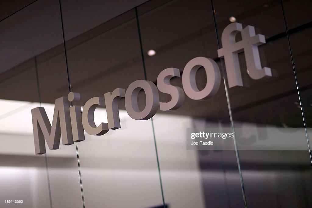 A Microsoft sign is seen as the new Windows 8.1 operating system is released at a Microsoft store in the Dadeland Mall October 17, 2013 in Miami, Florida. The update was released a year after Windows 8 was released and includes fixes to some of the problems people experienced with the initial release.