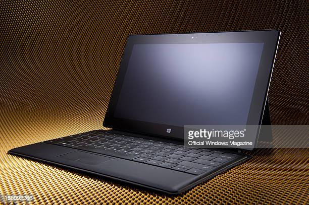 A Microsoft Surface Pro tablet PC with a keyboard photographed on a metallic mesh background taken on April 4 2013