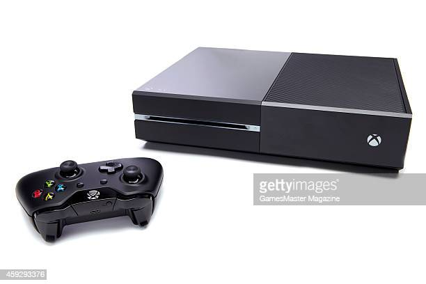 A Microsoft Xbox One video game console and wireless controller photographed on a white background taken on September 12 2013
