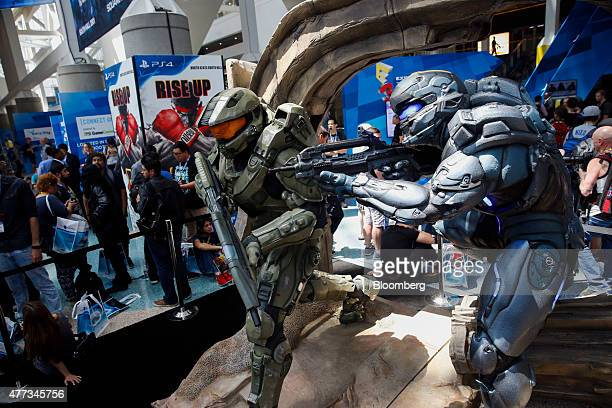 Microsoft Xbox's Halo 5 Guardians characters stand as attendees await the opening the E3 Electronic Entertainment Expo in Los Angeles California US...