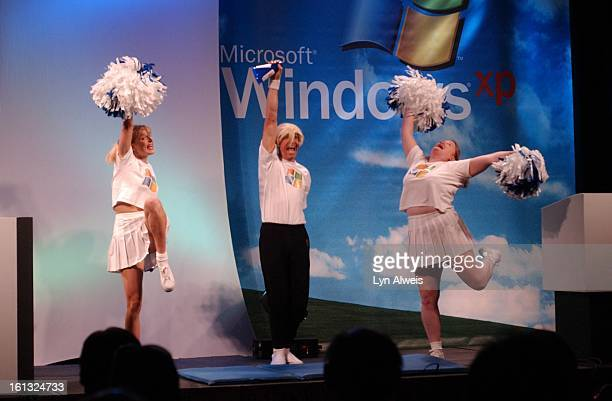 Microsoft's 'Pep Squad' does a comic cheer on the stage to help intoduce Microsoft Windows XP at an event at Denver's Adam's Mark Hotel attended by...