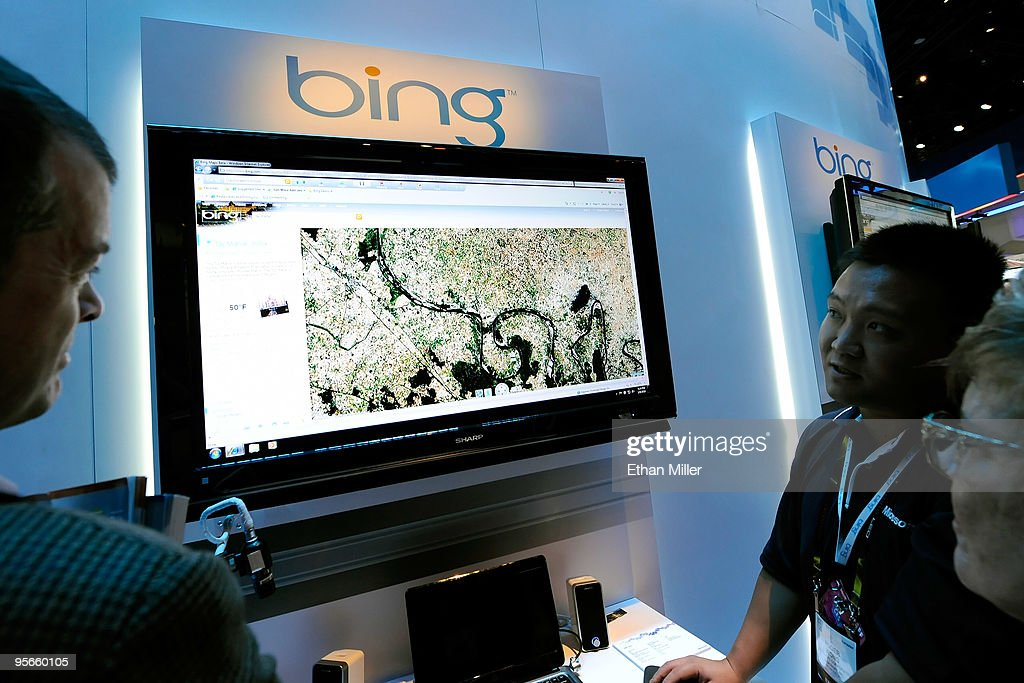 Microsoft's Roger Wong (2nd R) demonstrates maps using Bing at the 2010 International Consumer Electronics Show at the Las Vegas Convention Center January 8, 2010 in Las Vegas, Nevada. CES, the world's largest annual consumer technology trade show, runs through January 10 and is expected to feature 2,500 exhibitors showing off their latest products and services to about 110,000 attendees.