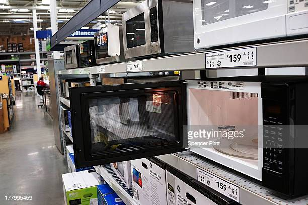Microwave ovens are on display in a home furnishing store on August 26 2013 in New York City A report on Monday showed that sales of durable goods...