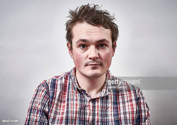 A mid 20's British male with a serious expression