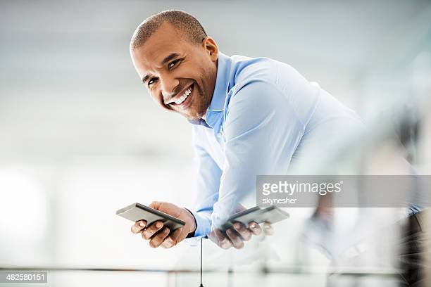 Mid adult businessman using cell phone.