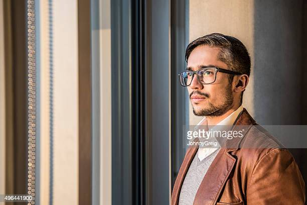 Mid adult businessman wearing glasses with beard, portrait
