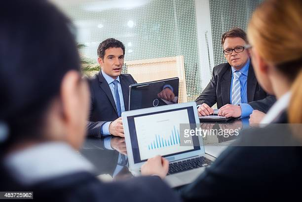 Mid adult businesswoman explaining sales report