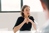 Mid adult businesswoman looking away at meeting