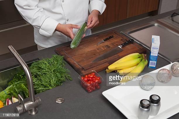Mid- adult chef prepares fresh food