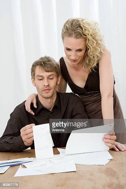 A mid adult couple doing home finances