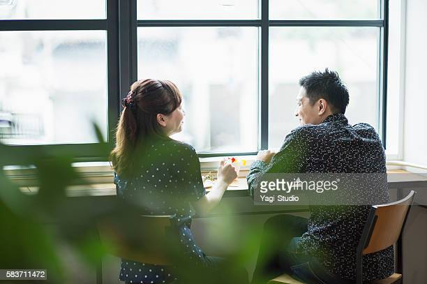 Mid adult couple enjoying Lunch in cafe.