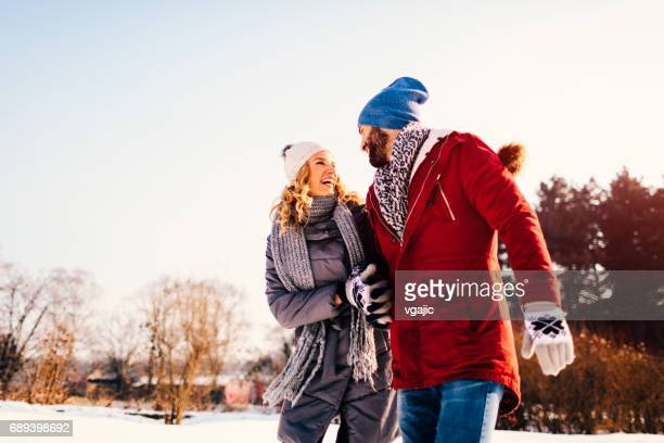 Mid Adult Couple Having Fun Outdoors At Winter