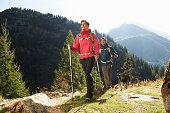 Mid adult couple hiking, Chamonix, Haute Savoie, France