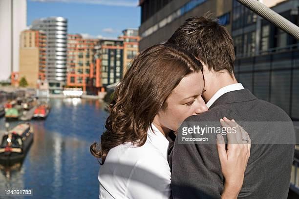 Mid Adult Couple Hugging at Bridge