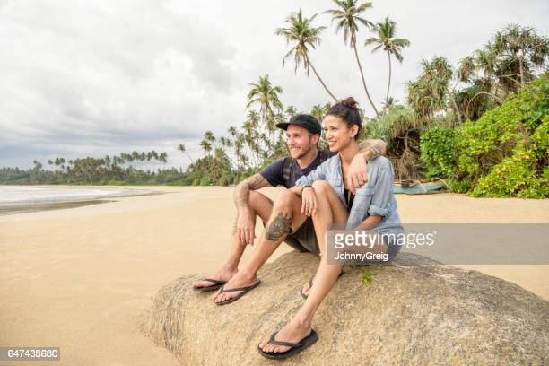 Mid adult couple on beach in Sri Lanka looking at view