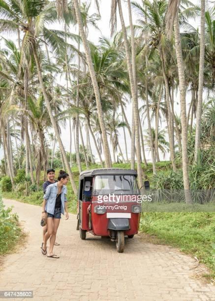 Mid adult couple on path with rickshaw, Sri Lanka